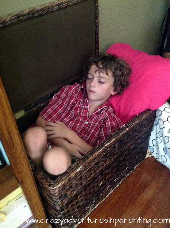 Kids sleep anywhere, even in the blanket basket.