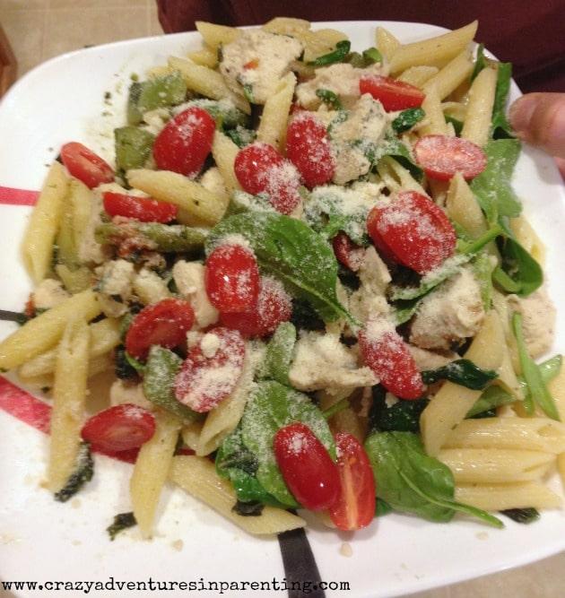 spinach tomato penne pasta dish