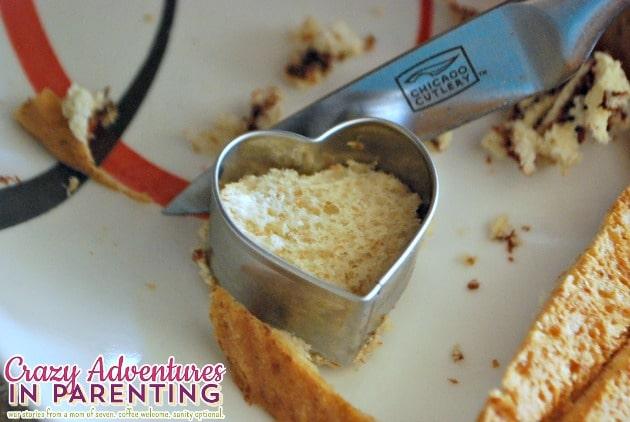 Making heart-shaped Nutella tea sandwiches