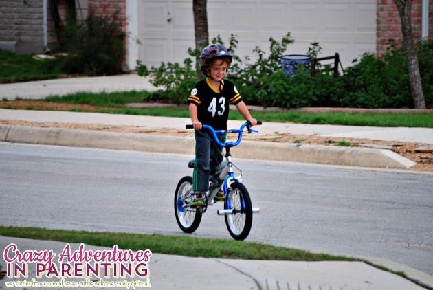 baby dude riding a two wheeler