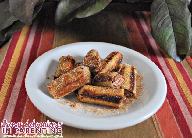 Nutella peanut butter cream cheese roll ups sprinkled with cinnamon sugar