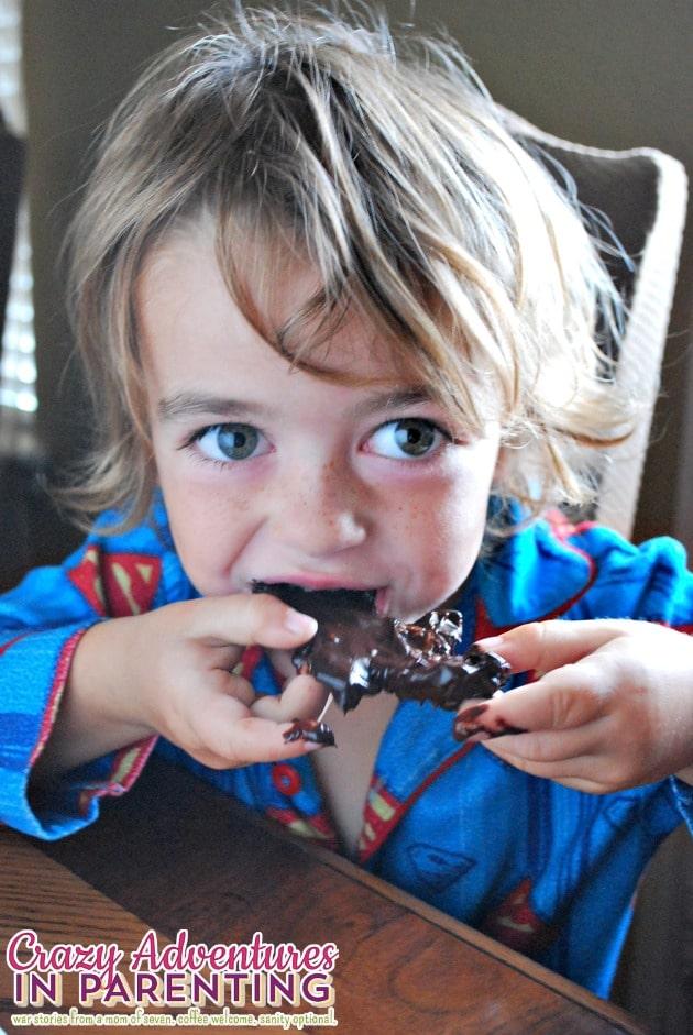 son eating Halloween waffles