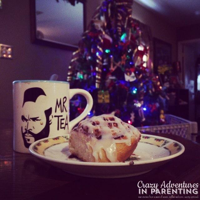 cinnamon bun and coffee by the christmas tree