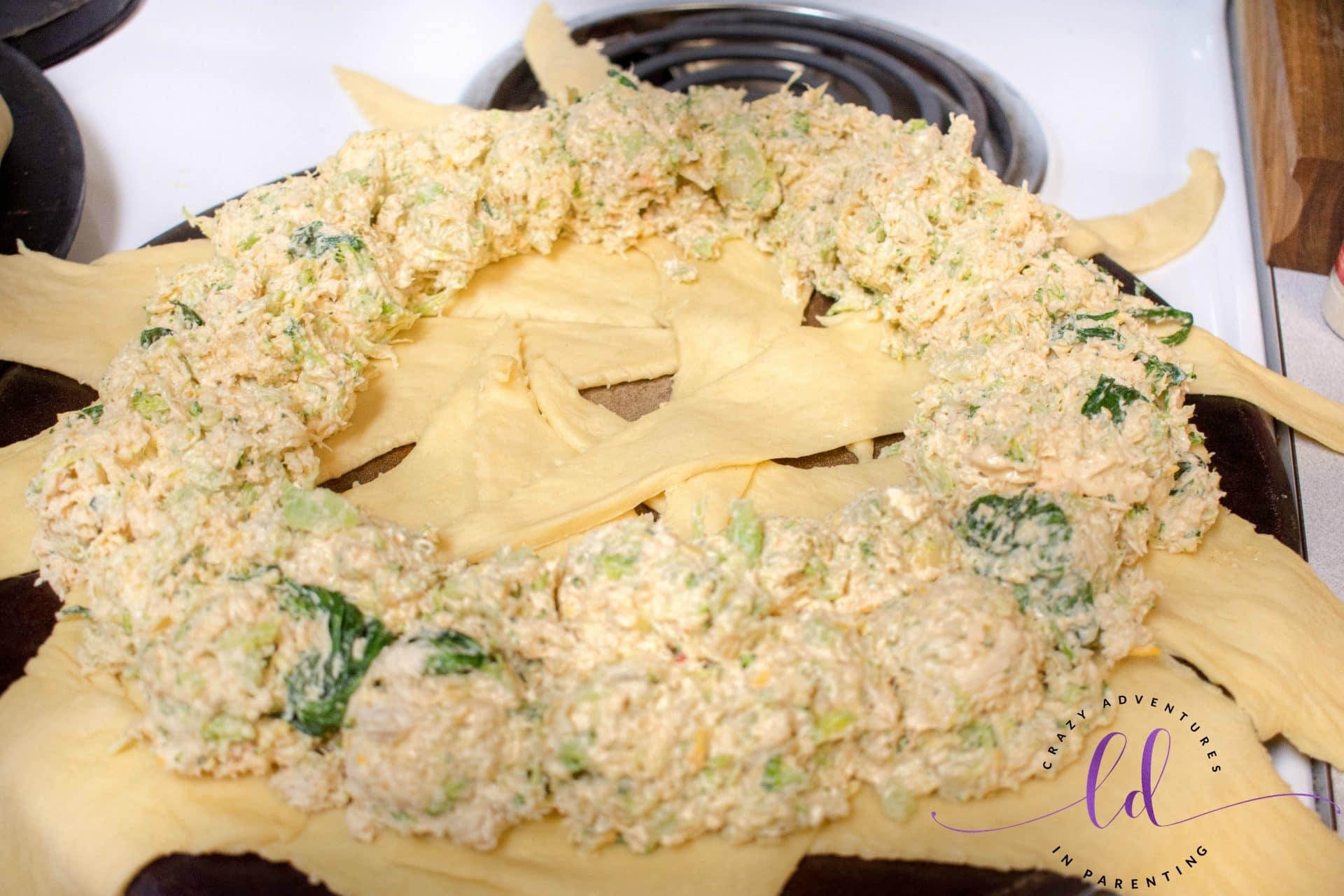 Preparing the Chicken Broccoli Spinach Artichoke Wreath