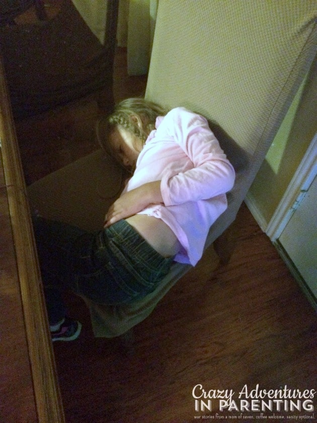 first grader asleep on dining chair