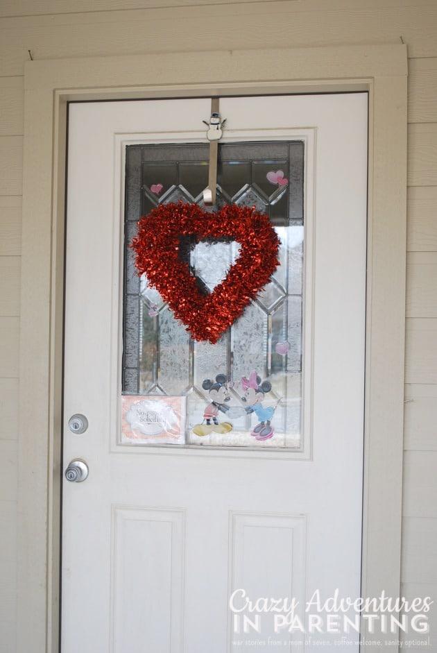 heart wreath on front door for Valentine's decorations