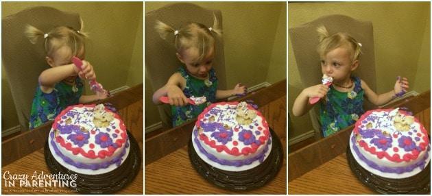 baby enjoying her smash cake