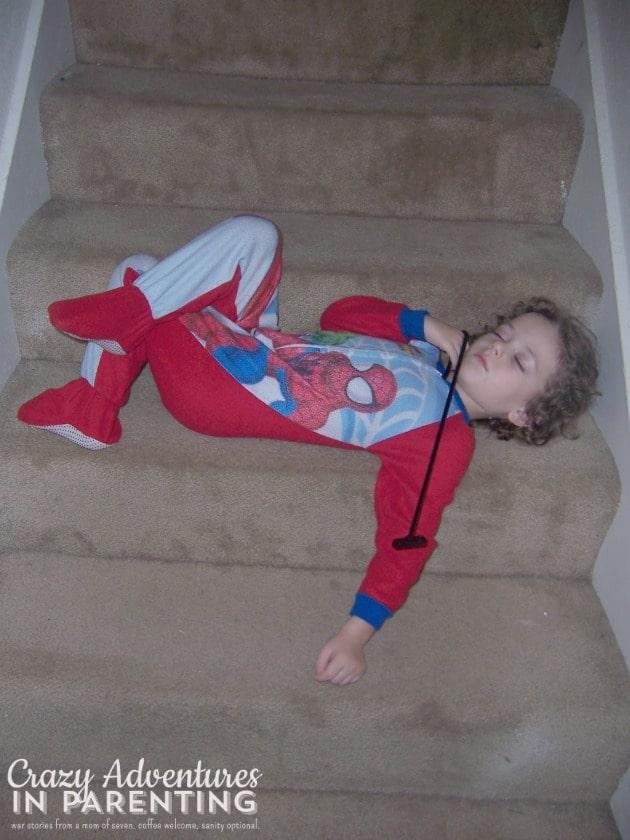 kid asleep on the stairs