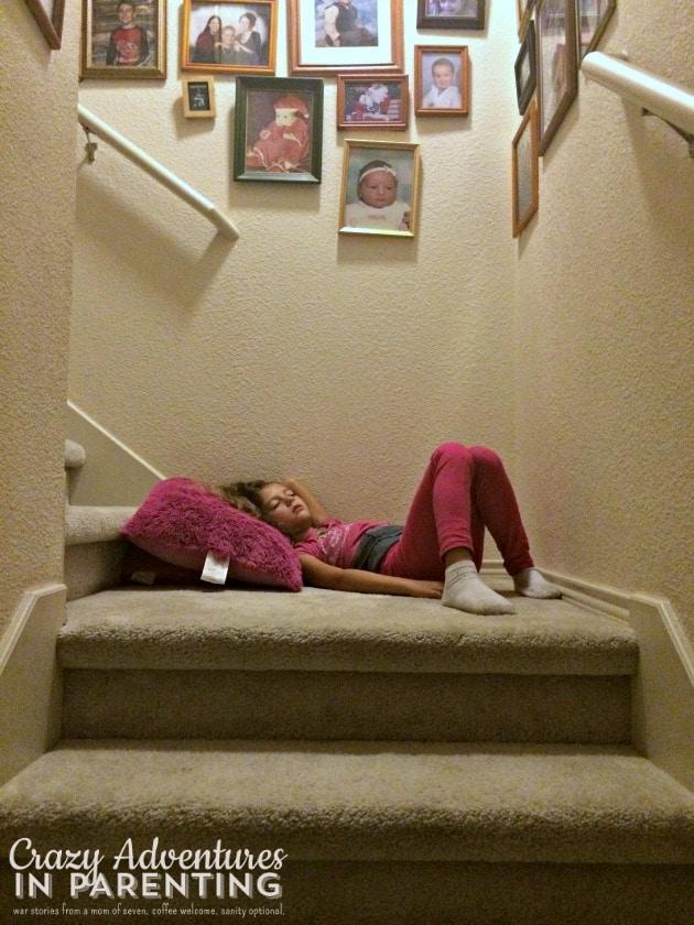 kids sleep anywhere - on the stairs