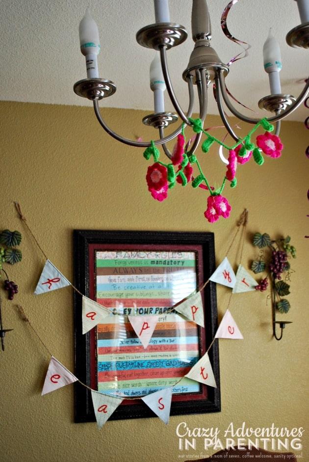 Flower garland hanging from chandelier