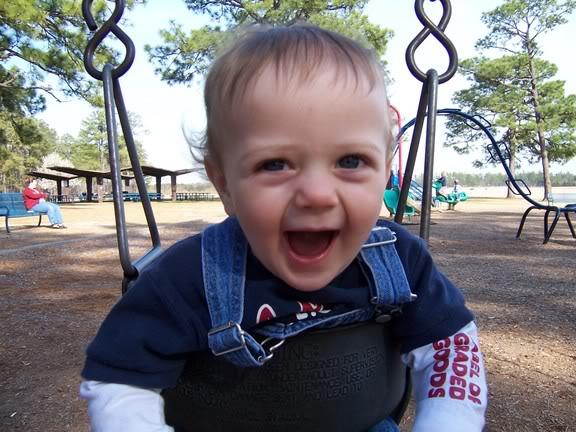 Happy on the swings