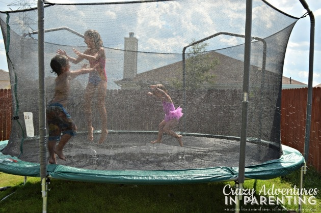 having a blast on the trampoline with the sprinkler