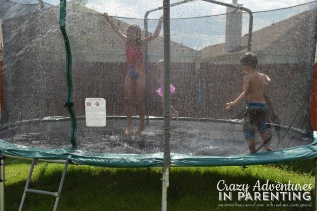 sprinkler trampoline fun