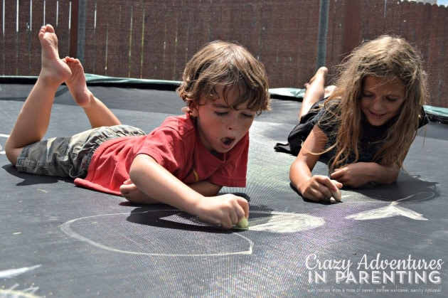 drawing with chalk on the trampoline