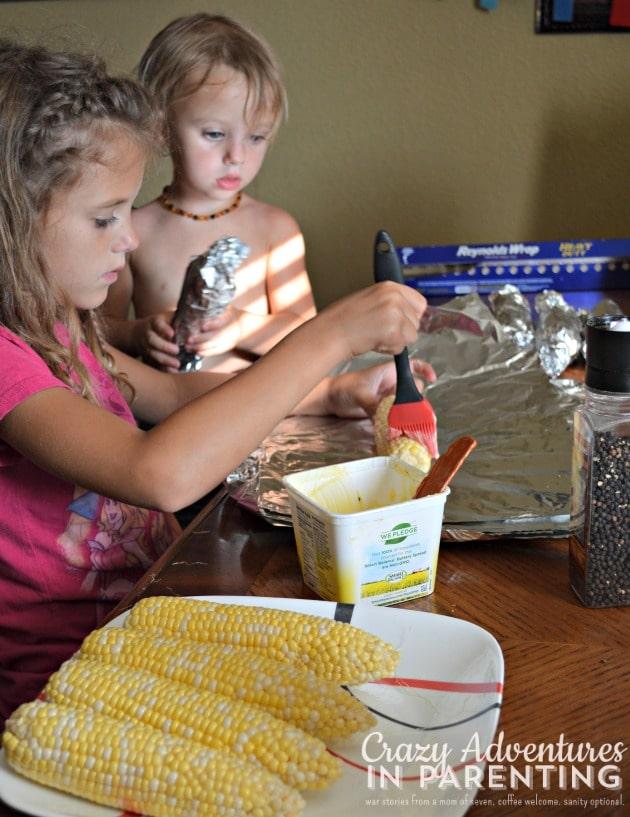 girls at work preparing corn on the cob