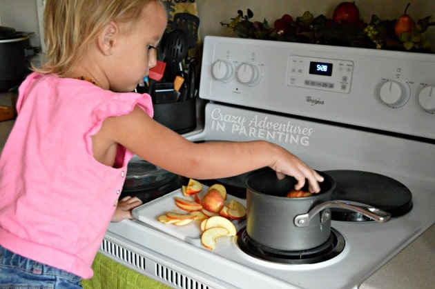 adding apple slices to the pot