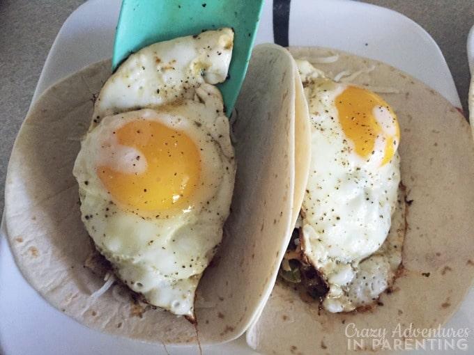 add fried eggs on top in breakfast wrap