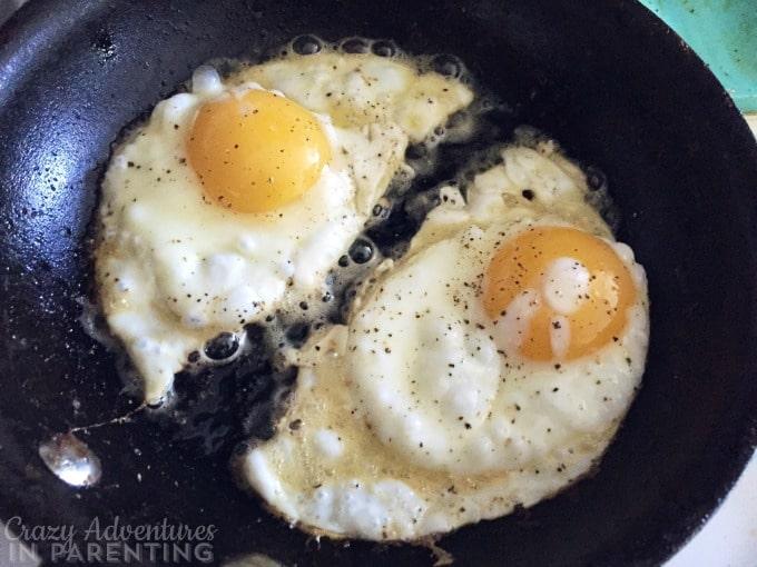 fried eggs cut in two