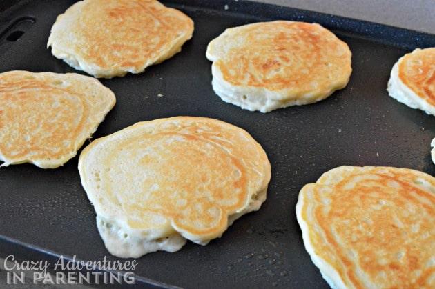 Cinnamon Roll Pancake Bake pancakes flipped