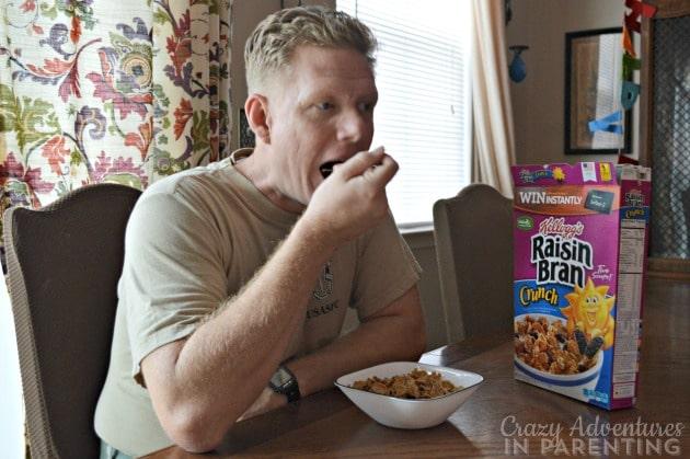 hubby eating Kellogg's Raisin Bran Crunch for breakfast before work
