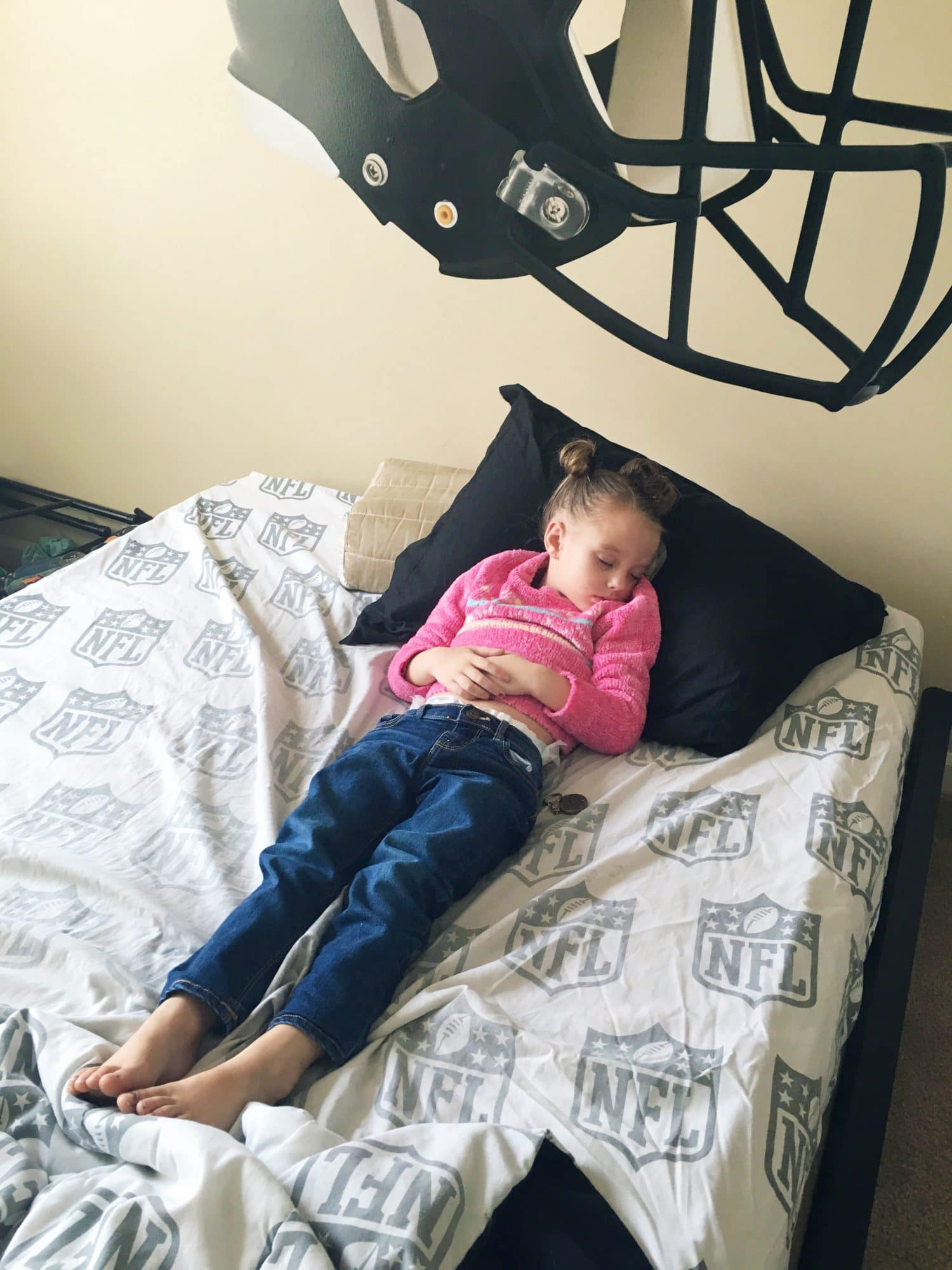 Sleeping toddler in brother's room