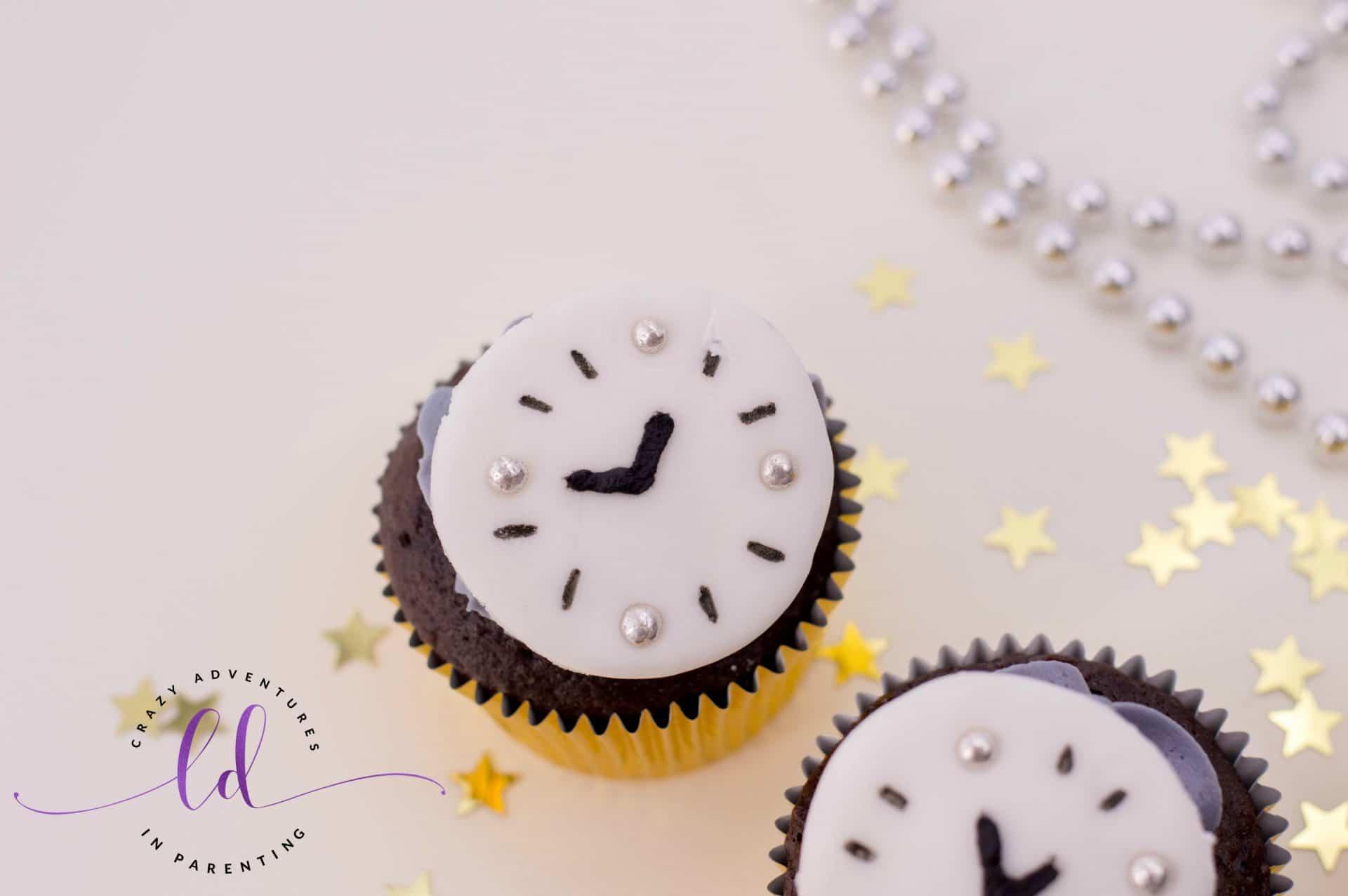 Place Fondant Clock on Countdown Cupcakes