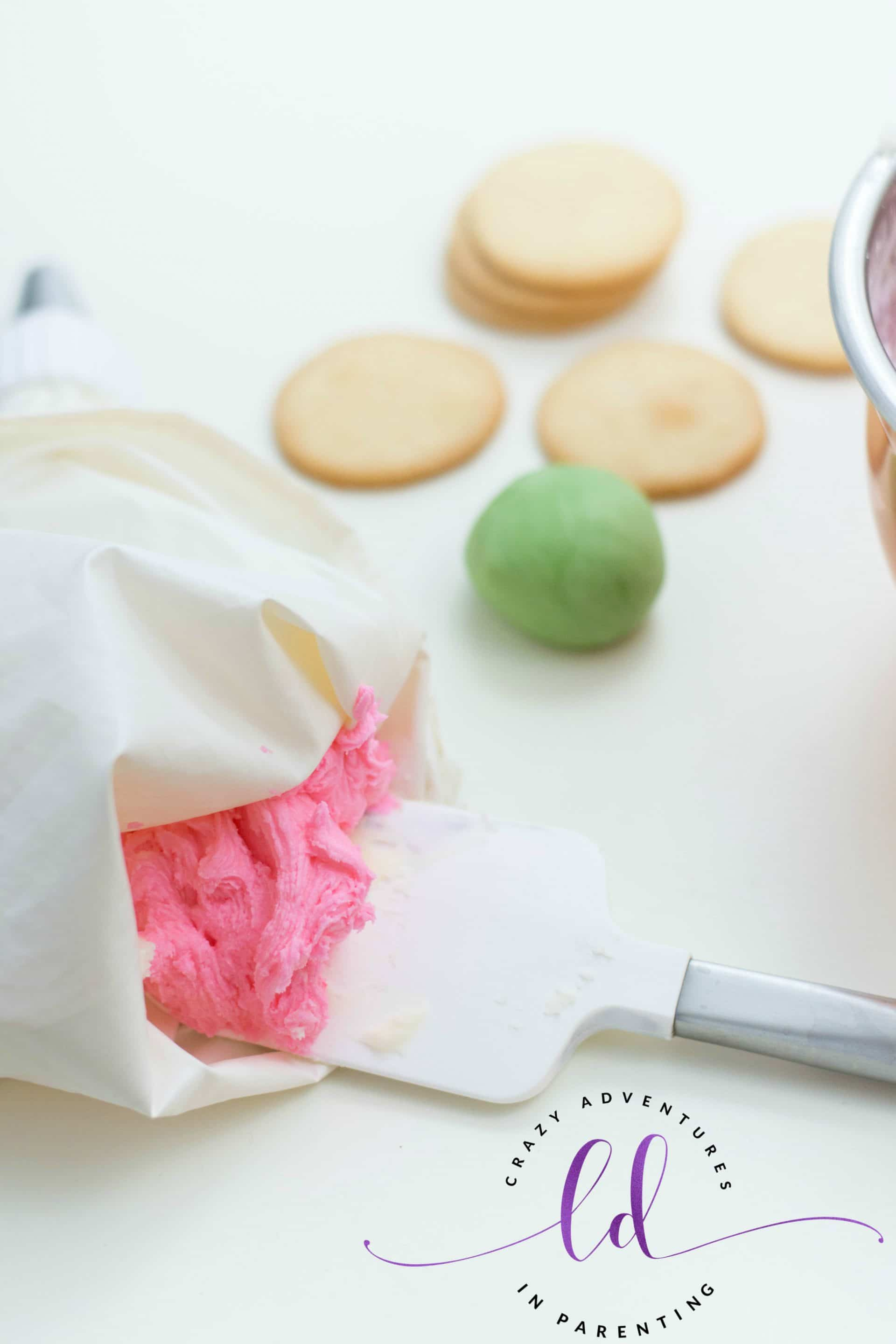 Scoop Buttercream into Piping Bag for Rose Sugar Cookies