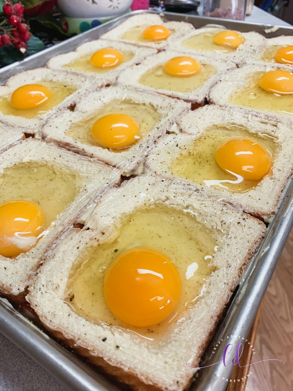 Eggs Cracked for Sheet Pan Cheesy Baked Egg Toast