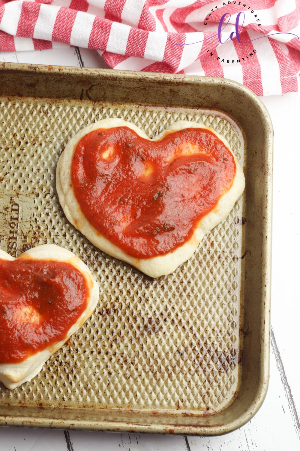 Add Sauce to Dough to Make Heart-Shaped Pizza for Valentine's Day