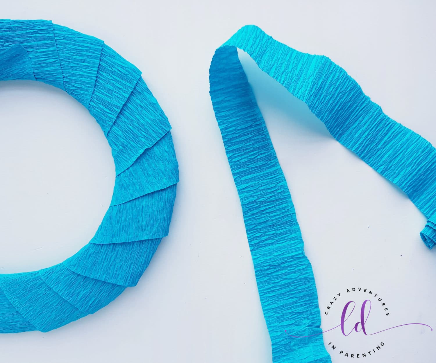 Use Crepe Paper Strips when Wrapping This Easy Frozen Wreath Craft