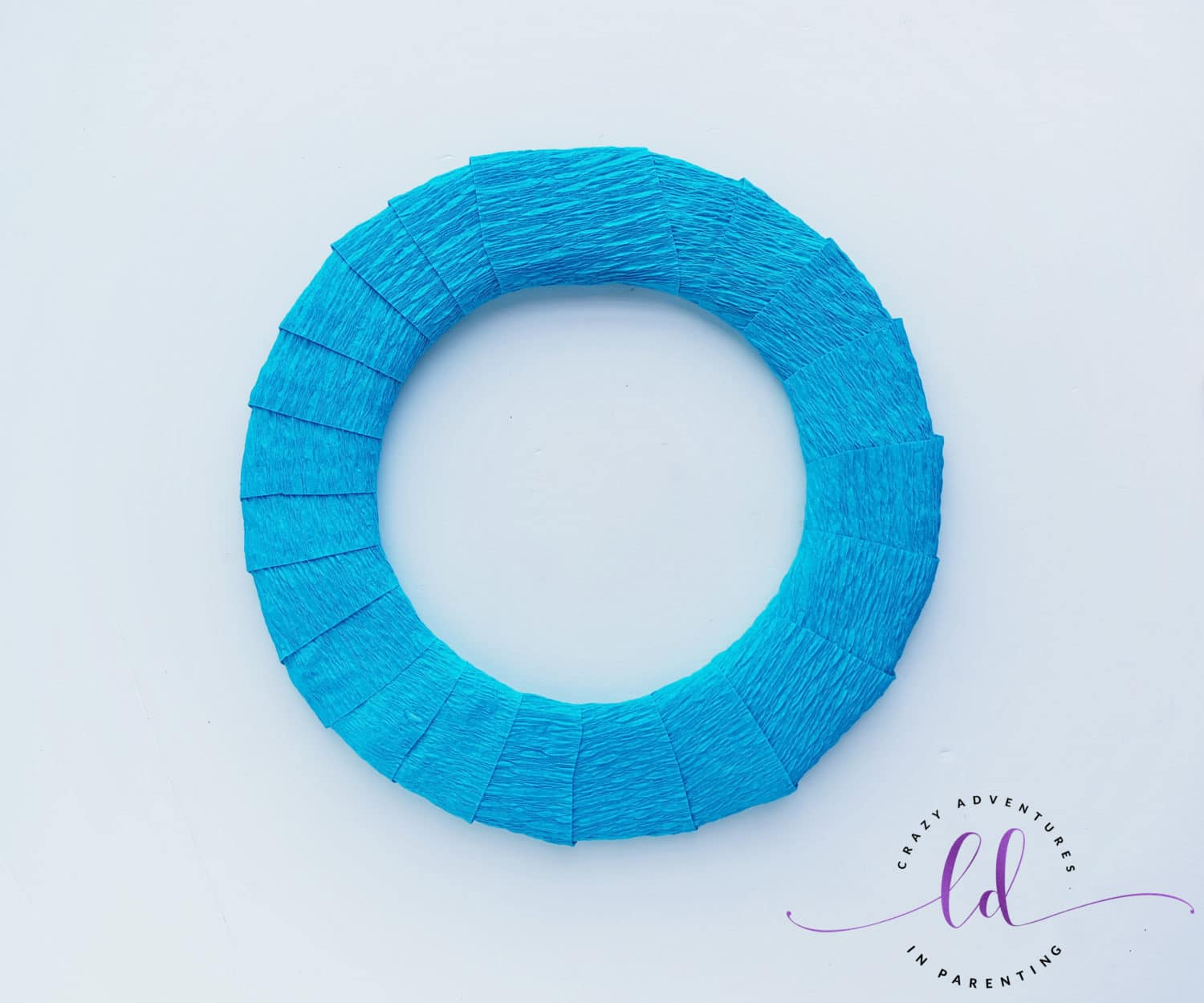 Wrapped Crepe Paper for This Easy Frozen Wreath Craft