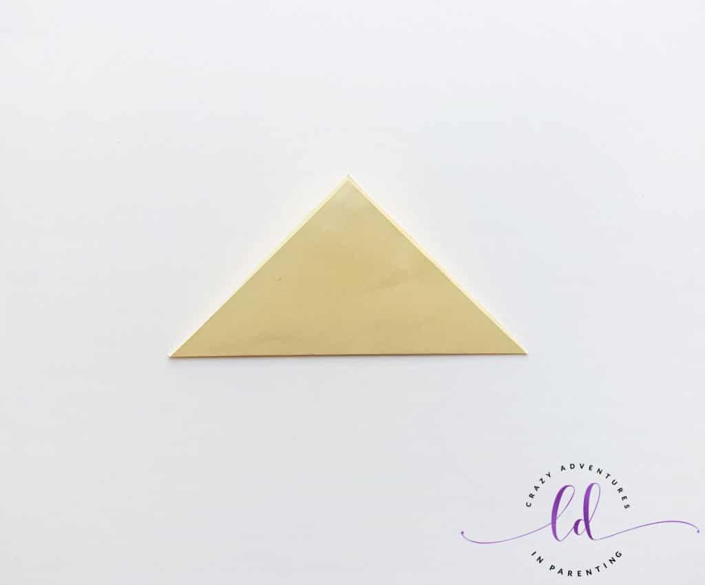 Fold Paper into Triangle for Unicorn Corner Bookmark
